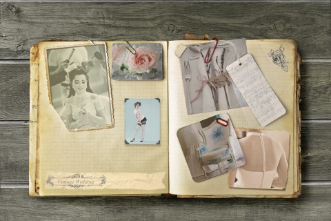 Vintage notebook with stained pages and wedding clip ideas