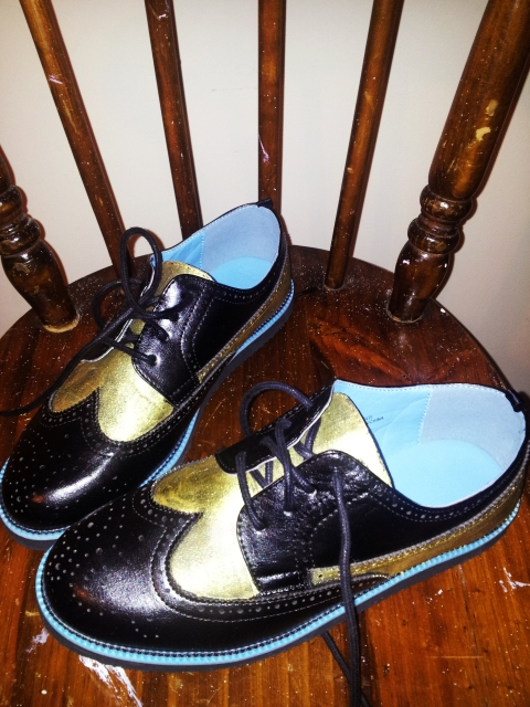 Black and gold brogues